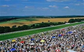 Glorious Goodwood Festival crowd with view over Downs